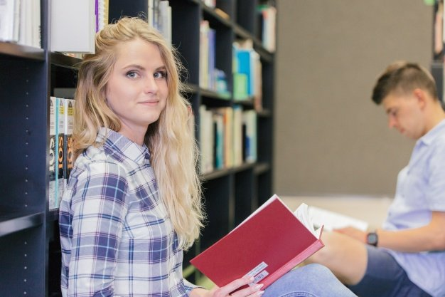 college-student-girl-in-library_23-2147678809